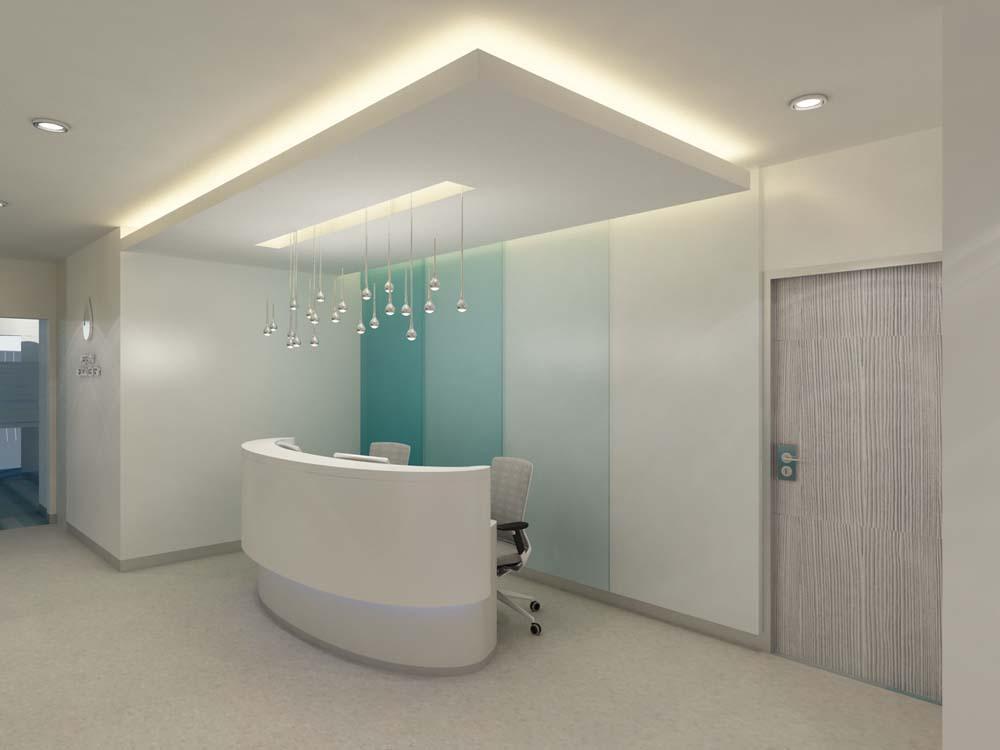 Interno di una reception con banco, sedie con rotelle, controsoffitto con area luce diffusa e luci spioventi.